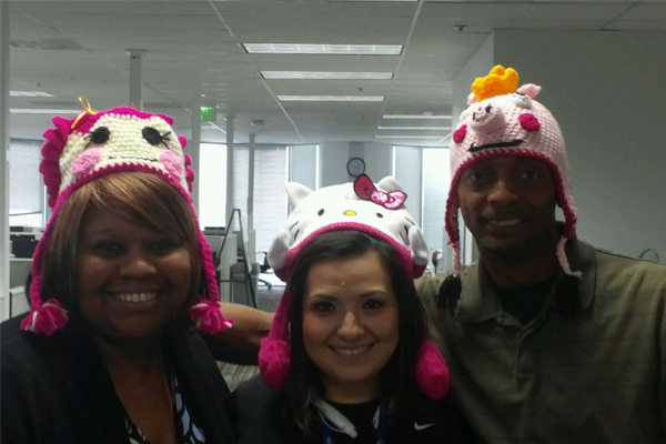 A Nielsen team wearing fun hats in the office