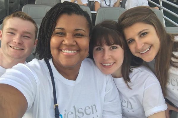 Nielsen client service and sales team posing for a picture