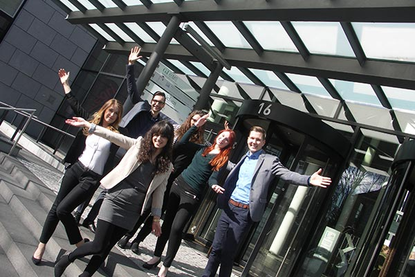 An exterior view of Nielsen's office in Germany with employees celebrating