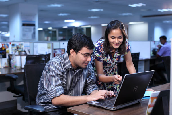 Nielsen employees collaborating in the Nielsen Gurgaon office.