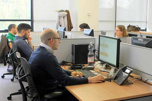 An interior view of the Nielsen office in Italy with employees hard at work