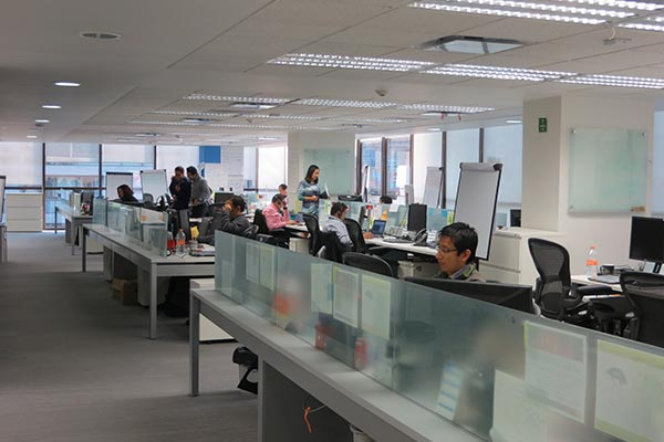 Nielsen employees working at their desks in the Mexico office