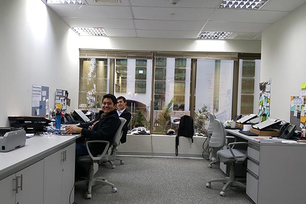 Nielsen employees working at their desks in the Peru office