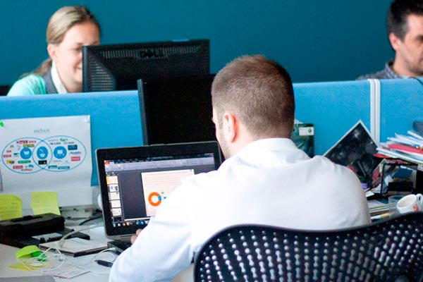 Several Nielsen employees working on their projects in the office in Serbia