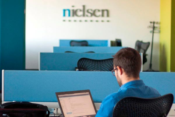 An interior view of the Nielsen office in Serbia with the Nielsen logo in the background