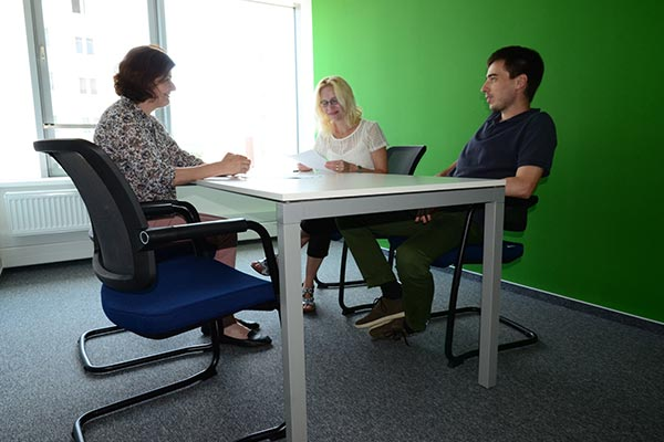 3 Nielsen employees in Slovakia conference room
