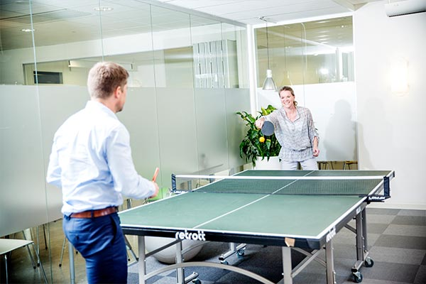 Two Nielsen employees on break playing ping pong in the Nielsen office in Sweden