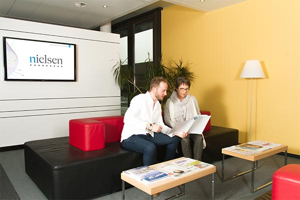 Nielsen Switzerland Office 2 employees discussing