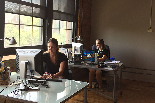 Two Nielsen Associates working hard at West Irving Park