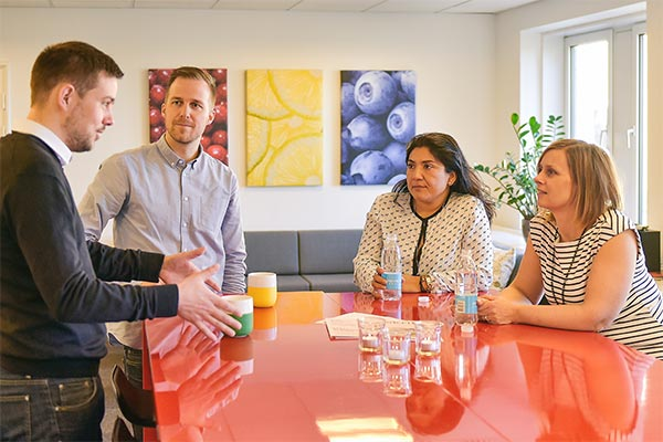 Several Nielsen employees having a meeting in the office in Denmark