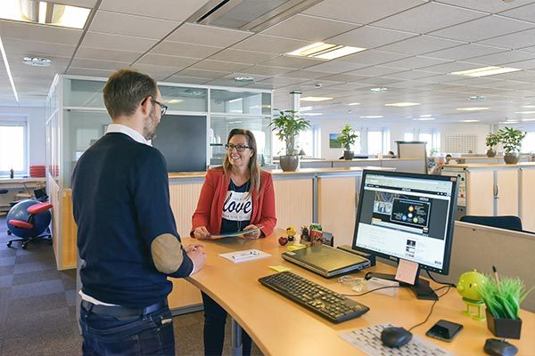 Several Nielsen employees collaborating on a project in the office in Denmark