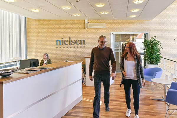 An interior view of the Nielsen office in Denmark with employees meeting
