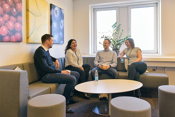 Employees enjoying the breakroom of Nielsen's office in Denmark