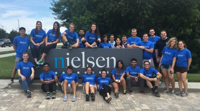 Interns wearing Nielsen volunteer shirts in Oldsmar