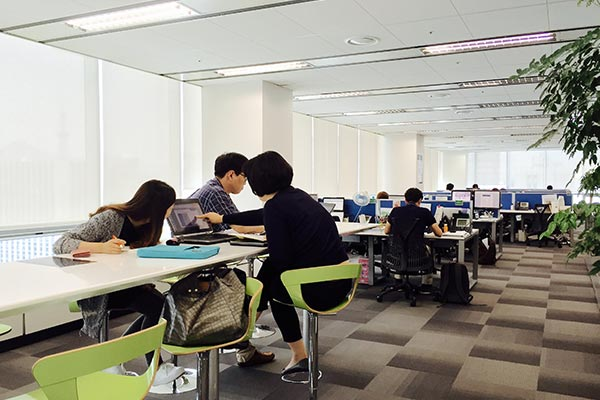Nielsen employees working at their desks in the Korea office