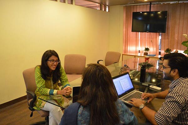 Several Nielsen employees having a meeting in the office in Pakistan
