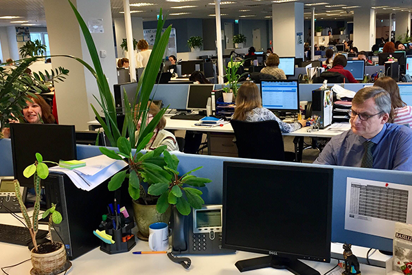 An interior view of the Nielsen office in Russia with employees collaborating on their project