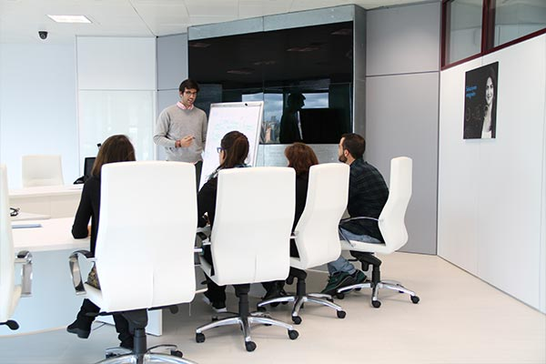 Several Nielsen employees having a meeting in the office in Spain