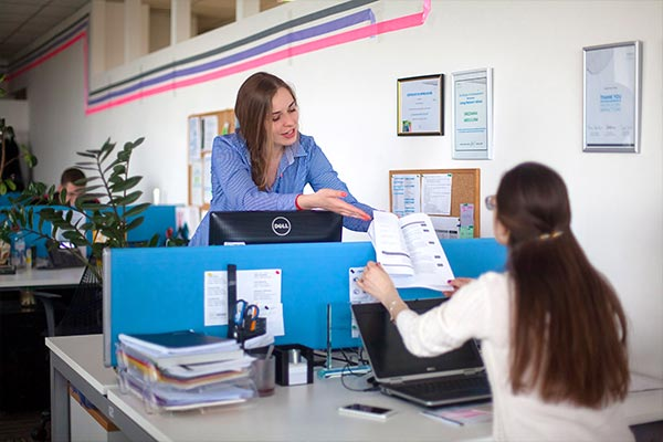Two Nielsen employees collaborating in the office in Ukraine