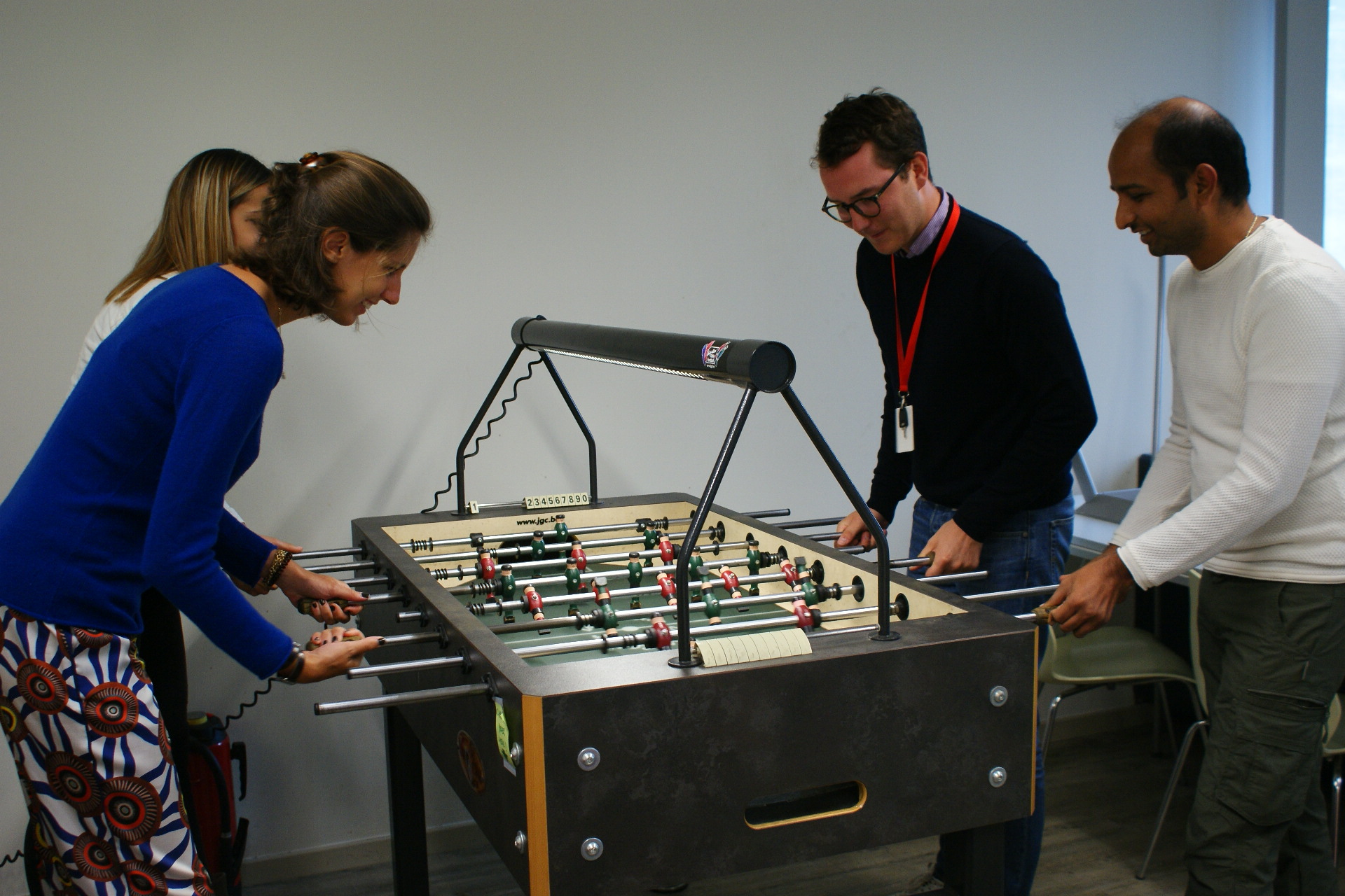 Four Belgian team members play table soccer
